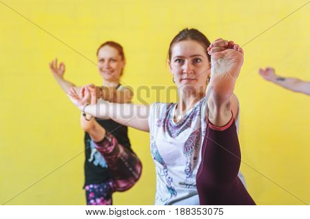 Group of middle aged caucasian women practicing yoga in class. Three female adults working out. Fitness and healthy lifestyle. Body balance training.
