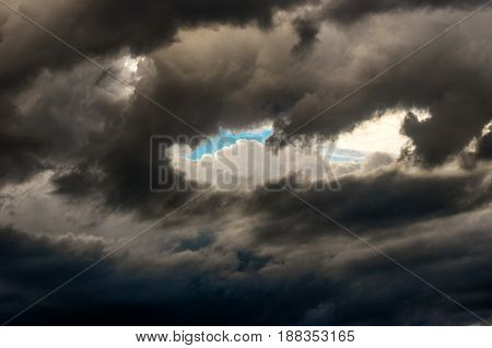Dramatic sunset sky with colorful clouds after thunderstorm