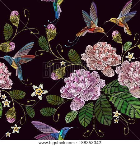 Embroidery peonies and humming bird seamless pattern. Fashionable template for clothes textiles t-shirt design. Beautiful peonies flowers and humming bird classical embroidery pattern
