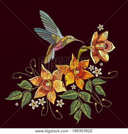 Humming bird and narcissus embroidery. Beautiful hummingbird and yellow narcissus embroidery on black background. Template for clothes textiles t-shirt design