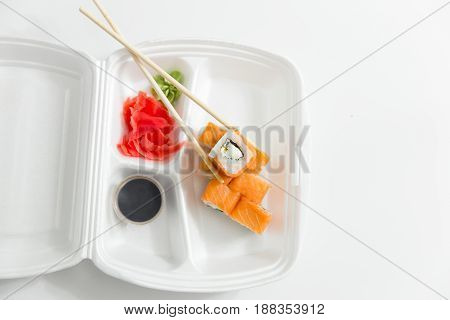 Roll With Chopsticks, Rolls, Sushi. Container Delivery Sushi And Chopsticks.