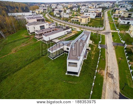 Modern country houses under construction as seen from air