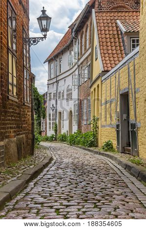 Cobblestoned Street With Colorful Houses In Luneburg