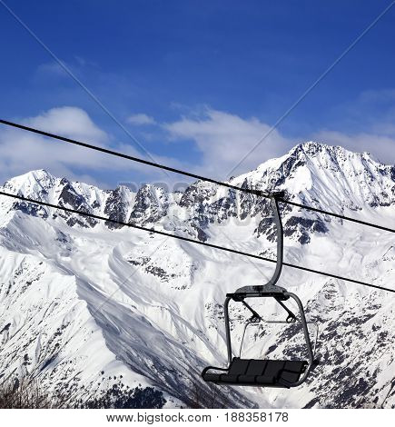 Chair-lift In Snow Winter Mountains At Nice Sun Day