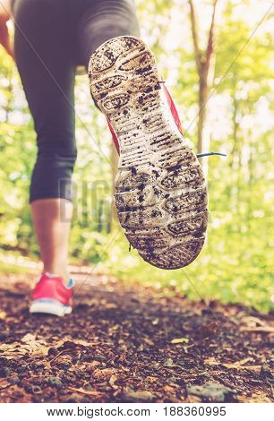 Woman Jogging Through The Woods