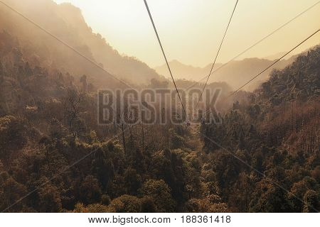 A cable railway in the mountains moving up