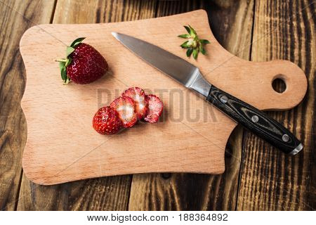 Strawberry On Cutting Board And Knife
