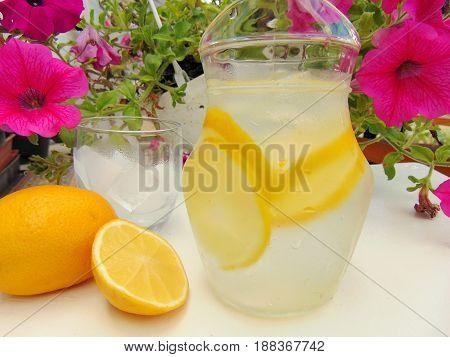 refreshing lemonade with lemon and ice cubes