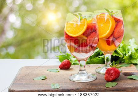 Flavored Water With Fresh Strawberries .