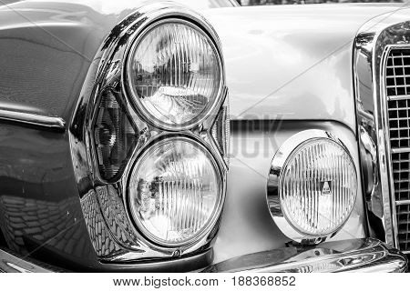 BERLIN GERMANY - MAY 17 2014: Headlamp of the executive car Mercedes-Benz 200 (W110). Black and white. 27th Oldtimer Day Berlin - Brandenburg