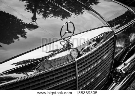 BERLIN GERMANY - MAY 17 2014: Hood ornament of the full-size luxury car Mercedes-Benz 450SEL (W116). Black and white. 27th Oldtimer Day Berlin - Brandenburg