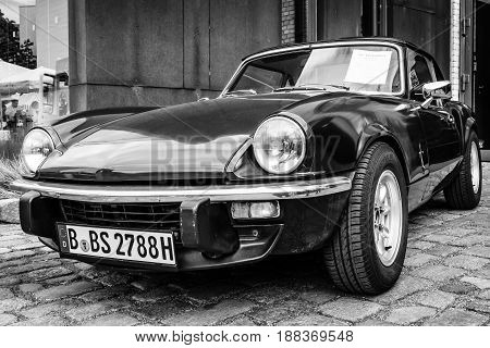 BERLIN GERMANY - MAY 17 2014: Sports coupe Triumph Spitfire Mark IV. Black and white. 27th Oldtimer Day Berlin - Brandenburg