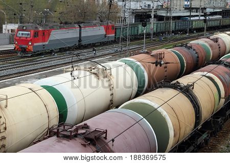 Wagons with coal and oil tankers are on station.