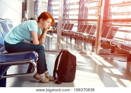 woman at the airport. waiting hall. flight delay