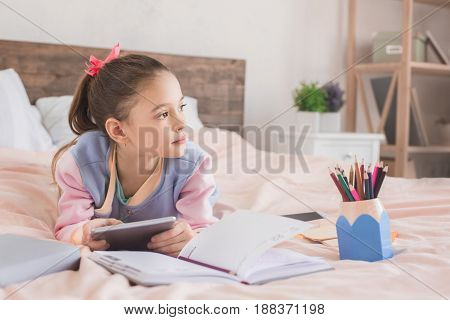 Young teenager girl alone at home childhood using digital device