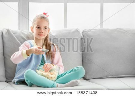 Young teenager girl alone at home childhood watching movie
