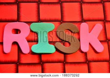 word risk on a  abstract red background
