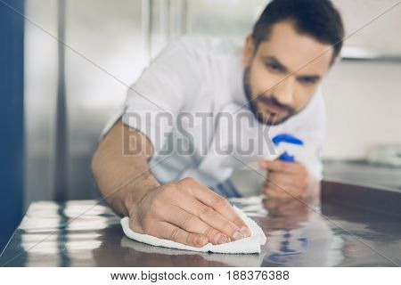 Male japanese restaurant chef working in the kitchen cleaning