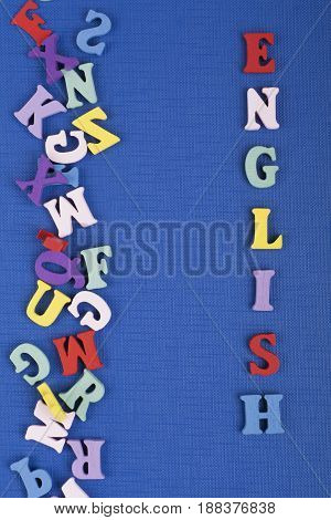 English word on blue background composed from colorful abc alphabet block wooden letters, copy space for ad text. Learning english concept