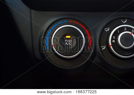 The panel of adjustment of the conditioner of the car.