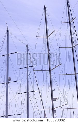 Masts of ships and sailboats against the sky
