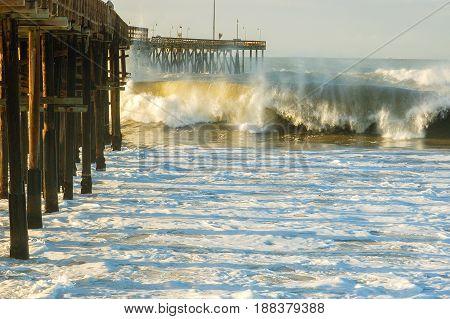 Big waves hitting a wood pier Ventura, CA