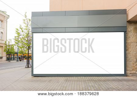 Mock up of big store blank showcase window in the classical building