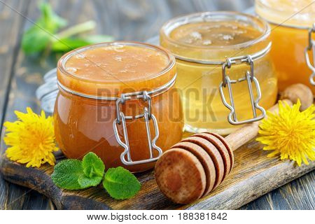 Buckwheat And Lime Honey In Glass Jars.