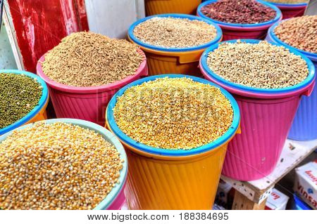 Bandar Abbas Hormozgan Province Iran - 16 april 2017: Plastic containers with dried seeds of peas corn and beans are put up for sale on the grocery market.
