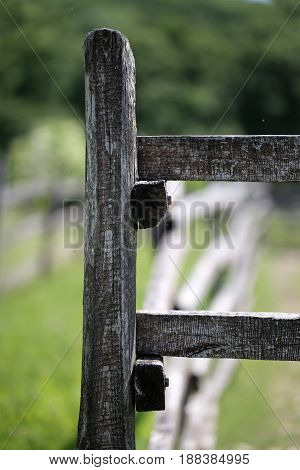 Old wooden corral fence in meadow rural scene bokeh mood
