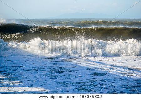 Big wave rolling in at beach in Ventura, CA