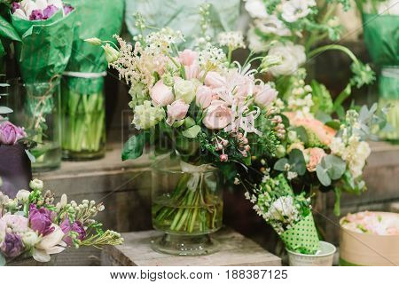 Tenderless bouquet of pink and white roses. petals and other flovers in vase
