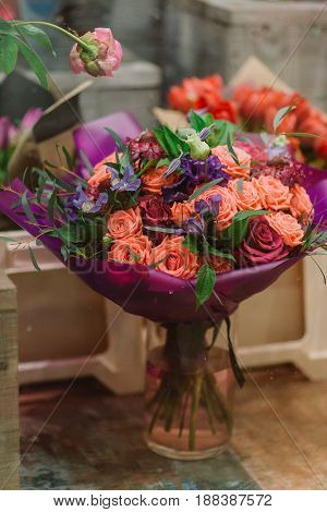Gorgeous and tenderless bouquet of pink and white roses. petals and other flovers in vase