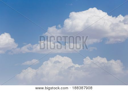 beautiful clouds on a blue sky . A photo