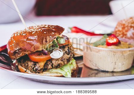Delicious Vegan Black Bean Burger With Vegetables And Hummus, Selective Focus