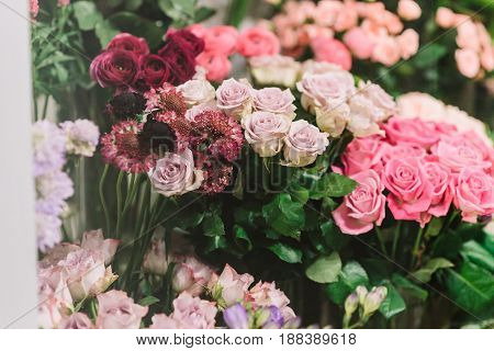 Gorgeous bouquets of pink, burgundy, beige roses and another flowers