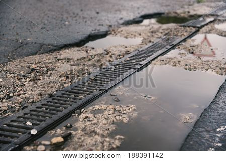 Road Drainage On The Roadside, Reflection Of The Environment In Water