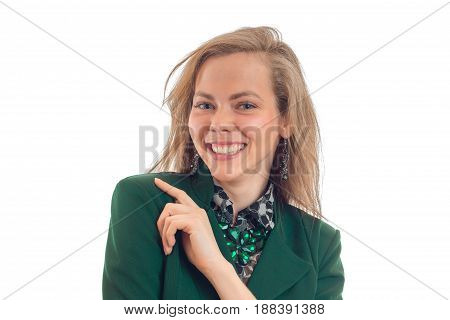 Portrait of a smiling young blond chic who looks into the camera and laughs close-up isolated on white background