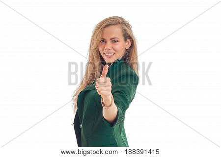 beautiful young girl smiling extends a hand forward and shows gesture class isolated on white background