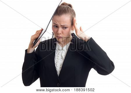 young beautiful business woman in chrenom suit keeps the hands behind the head and wrinkled her face close-up isolated on white background
