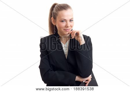 smiling sexy business woman in black suit stands up straight and looks into the camera close-up isolated on white background