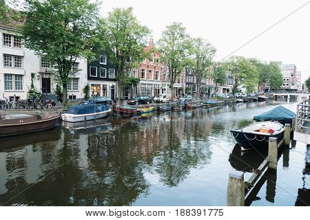 Amsterdam Netherlands - August 09 2016. Street and canals view in Amsterdam evening in summer