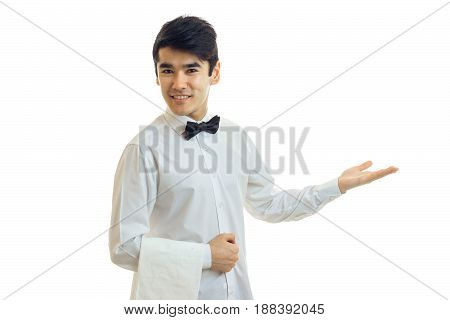 young friendly waiter smiles and stretches toward the hand isolated on white background