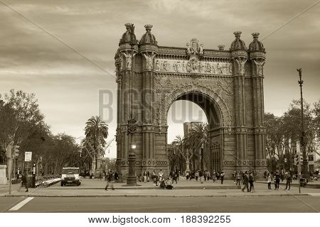 Barcelona Spain - 26 March 2017: People walking through the Arc de Triomf which is a triumphal arch in the city of Barcelona in Catalonia Spain.