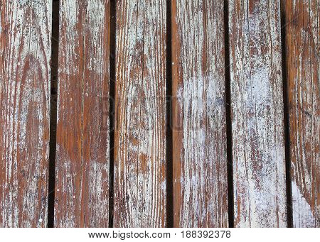 Old wooden slats with peeling paint.Background texture.