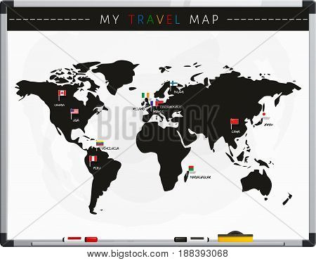Travel map with flags map pointers and marker pens on whiteboard.