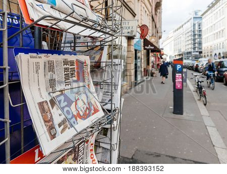 PARIS FRANCE - MAR 23 2017: Donald Trump Nope poster on cover of Liberation newspaper next to other international magazines covers at press kiosk newsstand featuring headlines