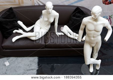 Female and male mannequin in anticipation of Assembly for exhibition, humorous story