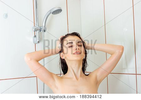 portrait of charming wet woman bathes in the shower