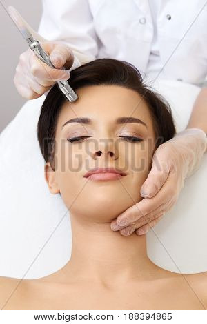 Hardware Cosmetology. Spa Clinic. Beautiful Woman At Skin Treatment Procedure. Microdermabrasion. Yo